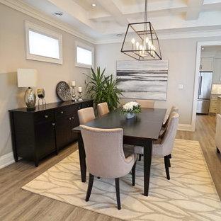 Cette image montre une salle à manger ouverte sur le salon design de taille moyenne avec un mur gris, un sol en vinyl, aucune cheminée, un sol gris et un plafond à caissons.