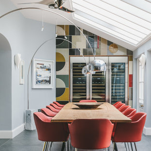 Photo of a medium sized classic enclosed dining room in Other with multi-coloured walls, no fireplace and grey floors.