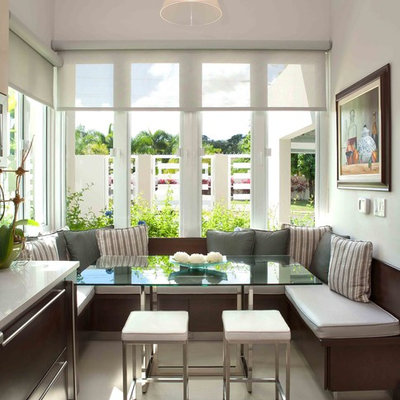 Example of a mid-sized trendy ceramic tile kitchen/dining room combo design in Other with white walls
