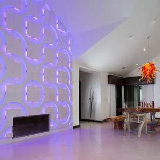 Contemporary dining room in Orlando with limestone floors.