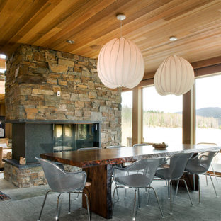 Continental Divide - Colorado Modern Mountain Home Dining Room with Fireplace