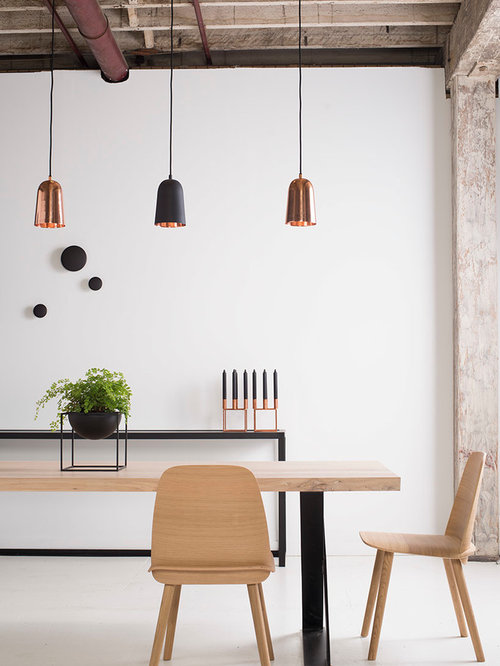 Large Urban Dining Room Photo In Sydney With White Walls