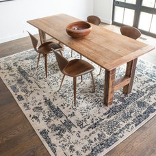 Transitional Dining Room by Rugs Done Right