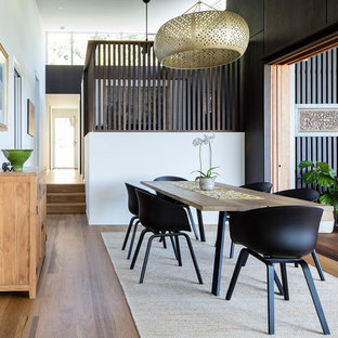 Inspiration for a mid-sized contemporary dining room in Sunshine Coast with white walls and dark hardwood floors.
