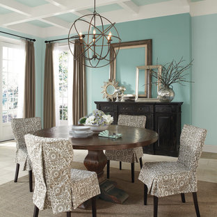 Example of a classic dining room design in Columbus with blue walls