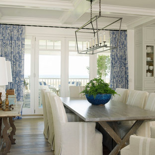 Design ideas for a large beach style open plan dining room in San Diego with white walls and light hardwood flooring.
