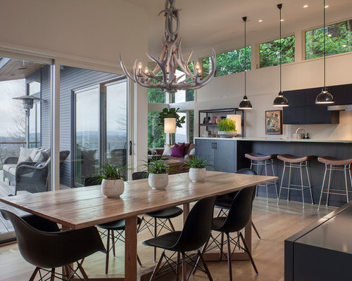 example of a trendy great room design in portland - Black Dining Room