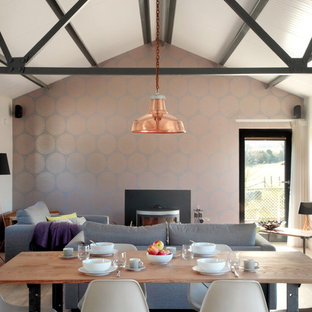 Example of a mid-sized cottage light wood floor kitchen/dining room combo design in Buckinghamshire with metallic walls