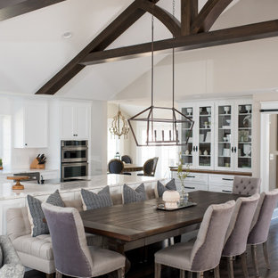 Large transitional dark wood floor and brown floor breakfast nook photo in Indianapolis with no fireplace and beige walls