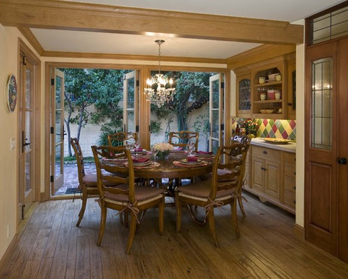 traditional dining room idea in los angeles with beige walls and dark hardwood floors - Country Dining Room Design
