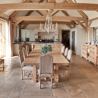 Inspiration for a farmhouse kitchen/dining room in Wiltshire with white walls, no fireplace, beige floors and limestone flooring.