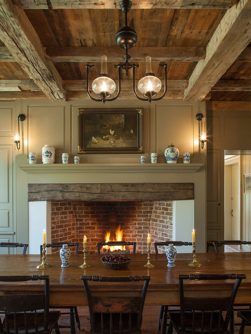 lighting fireplace. example of a mountain style dining room design in boise with green walls and standard lighting fireplace r