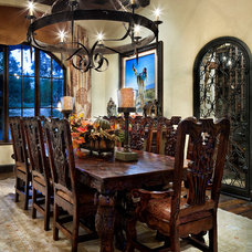 Mediterranean Dining Room by chas architects