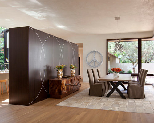 Inspiration For A Contemporary Medium Tone Wood Floor Dining Room Remodel In Austin With Beige Walls