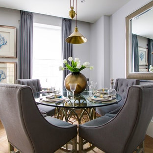 Photo of a traditional dining room in London with grey walls and light hardwood flooring.