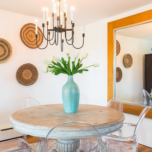 Inspiration for an eclectic medium tone wood floor dining room remodel in New York with white walls