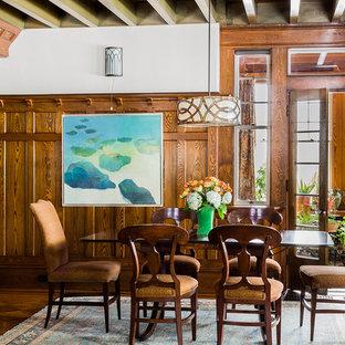 Foto de comedor de estilo americano, grande, abierto, con suelo de madera en tonos medios y paredes beige