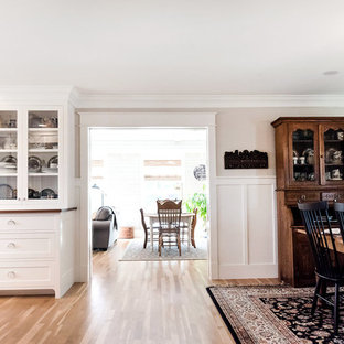 Example of an arts and crafts dining room design in Denver