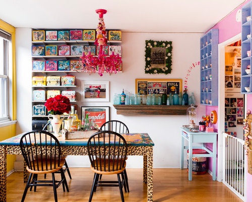 Small Eclectic Medium Tone Wood Floor Dining Room Idea In New York With  Multicolored Walls