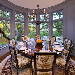 Elegant dark wood floor dining room photo in Charleston with gray walls