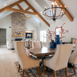 Example of a country light wood floor and beige floor great room design in Austin with beige walls, a standard fireplace and a brick fireplace