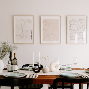 Mid-sized scandinavian dining room in Sydney with white walls.
