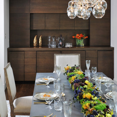 Enclosed dining room - large contemporary dark wood floor and brown floor enclosed dining room idea in San Francisco with beige walls