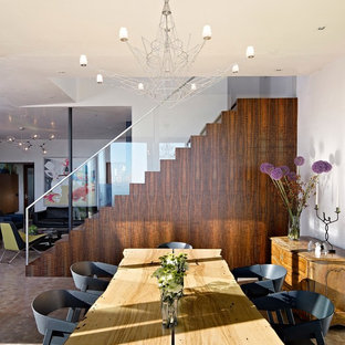 This is an example of a medium sized midcentury enclosed dining room in San Francisco with white walls, beige floors and no fireplace.