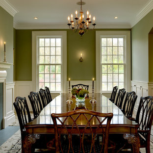 Elegant carpeted dining room photo in New York with green walls and a standard fireplace