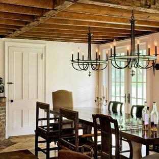 Immagine di una sala da pranzo country con pareti bianche, camino ad angolo e cornice del camino in mattoni