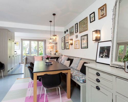 Scandinavian Painted Wood Floor Dining Room Idea In London With White Walls