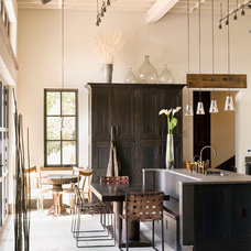 Rustic Dining Room by Kahn Design Associates