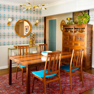 Small eclectic medium tone wood floor and brown floor enclosed dining room photo in Los Angeles with white walls