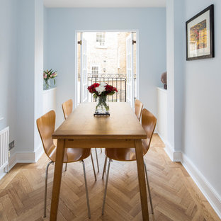 Photo Of A Clic Dining Room In London With Blue Walls Light Hardwood Flooring And