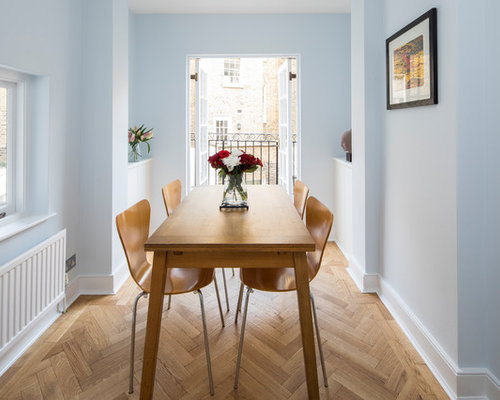 Photo Of A Classic Dining Room In London With Blue Walls Light Hardwood Flooring And