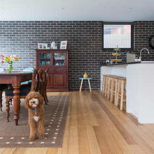 Transitional kitchen/dining combo in Sydney with medium hardwood floors and no fireplace.