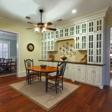 Traditional Dining Room by Suiter Construction Company, Inc.