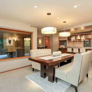 Trendy beige floor kitchen/dining room combo photo in Seattle with beige walls and no fireplace