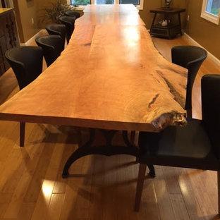 На фото: большая отдельная столовая в стиле современная классика с коричневыми стенами, светлым паркетным полом и коричневым полом без камина с