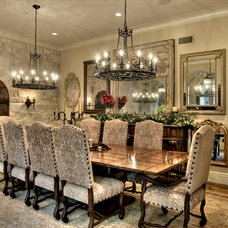 Mediterranean Dining Room by Allan Edwards Builder Inc