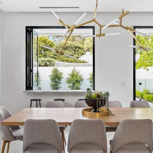 Foto de comedor moderno, grande, abierto, con paredes blancas, suelo de cemento y suelo blanco