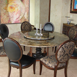 Custom-made natural stone table - This one-of-a-kind 6 foot diameter granite dining table seats 8 at formal and informal meals. Laser cut and polished finish includes a matching 24 inch center-placed Lazy Susan.  Custom made chairs in complementary leather and fabric.