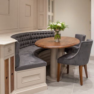 Photo of a medium sized classic dining room in West Midlands with banquette seating, beige walls and grey floors.