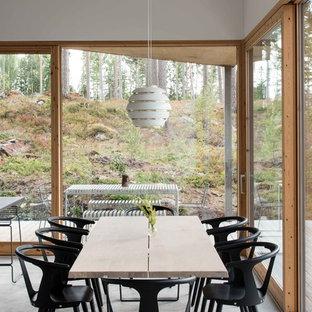 Idéer för en modern separat matplats, med betonggolv och grått golv