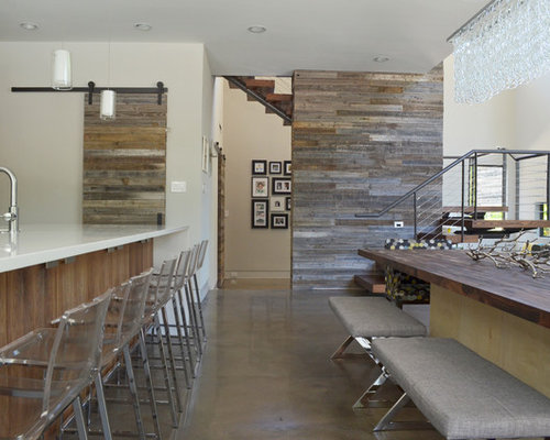Inspiration For A Contemporary Kitchen Dining Combo Remodel In Dallas With White Walls And Concrete