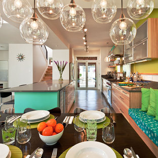 Example of a trendy dining room design in Austin with green walls