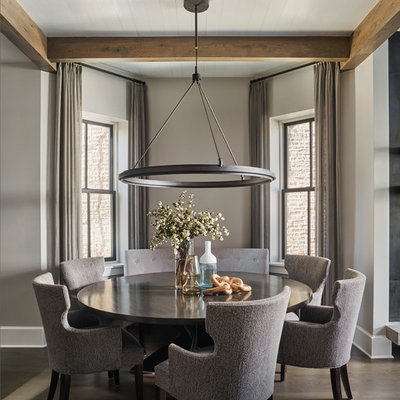 Inspiration for a large contemporary dark wood floor and brown floor great room remodel in Chicago with gray walls and no fireplace