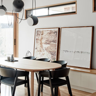 Inspiration For A Modern Open Plan Dining In Melbourne With White Walls And Light Hardwood Floors