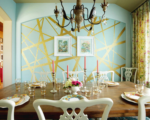 inspiration for an eclectic enclosed dining room remodel in houston with blue walls