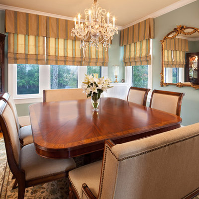 Example of a large classic medium tone wood floor and brown floor enclosed dining room design in DC Metro with green walls and no fireplace